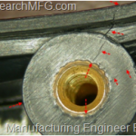 How come the screw boss crack after mold-in screw insert?